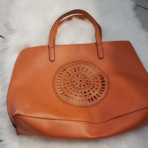 Neiman marcus orange tote with laser cut detail